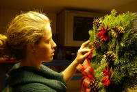 Kim decorating wreaths
