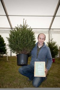 Rory Young with the winning pot grown Christmas tree