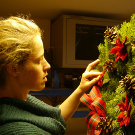 the final touches being-put to a wreath use tree team